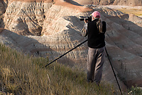Rod Planck Photographing, Badlands National Park, South Dakota, Hand-holding Composition